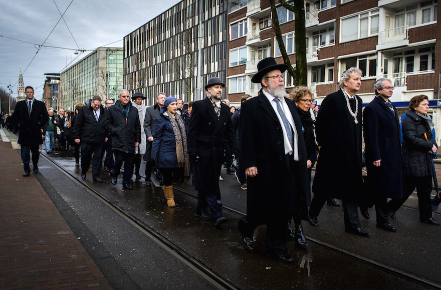 Mayor of Amsterdam Eberhard van der Laan (4th R) leads a march from City Hall to the Auschwitz monument in the Wertheimpark in Amsterdam on January 26, 2014, during the national memorial day for the victims of the Holocaust. AFP PHOTO / ANP / REMKO DE WAAL **NETHERLANDS OUT** (Photo credit should read REMKO DE WAAL/AFP/Getty Images)